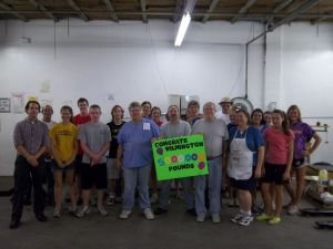 Food Bank volunteers and staff celebrate 5 million pounds distributed with Ted Mercer from Burgaw PFWB.